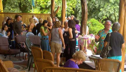 Attendees socializing and buying books.